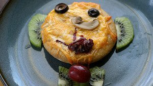 Kid-Constructed Funny Face Mini Pizzas Recipe